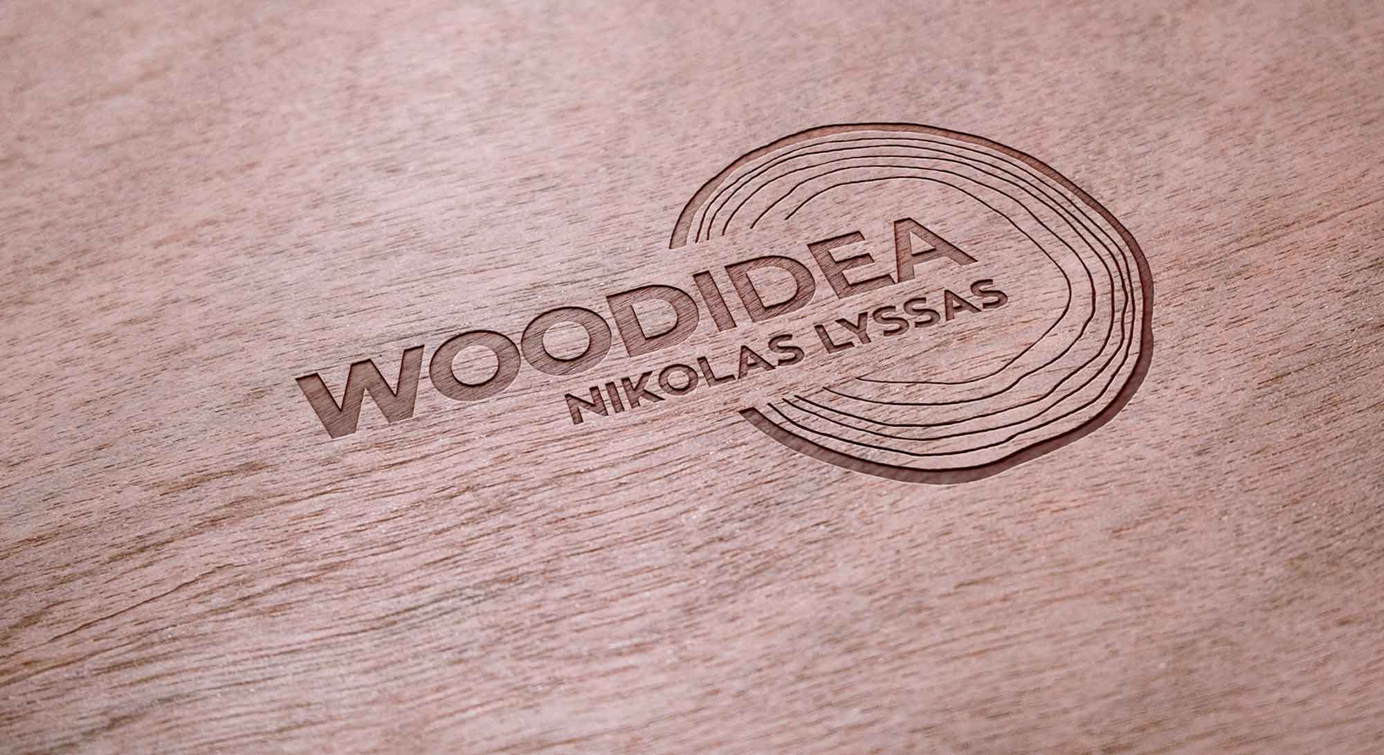 logo design engraved on wood