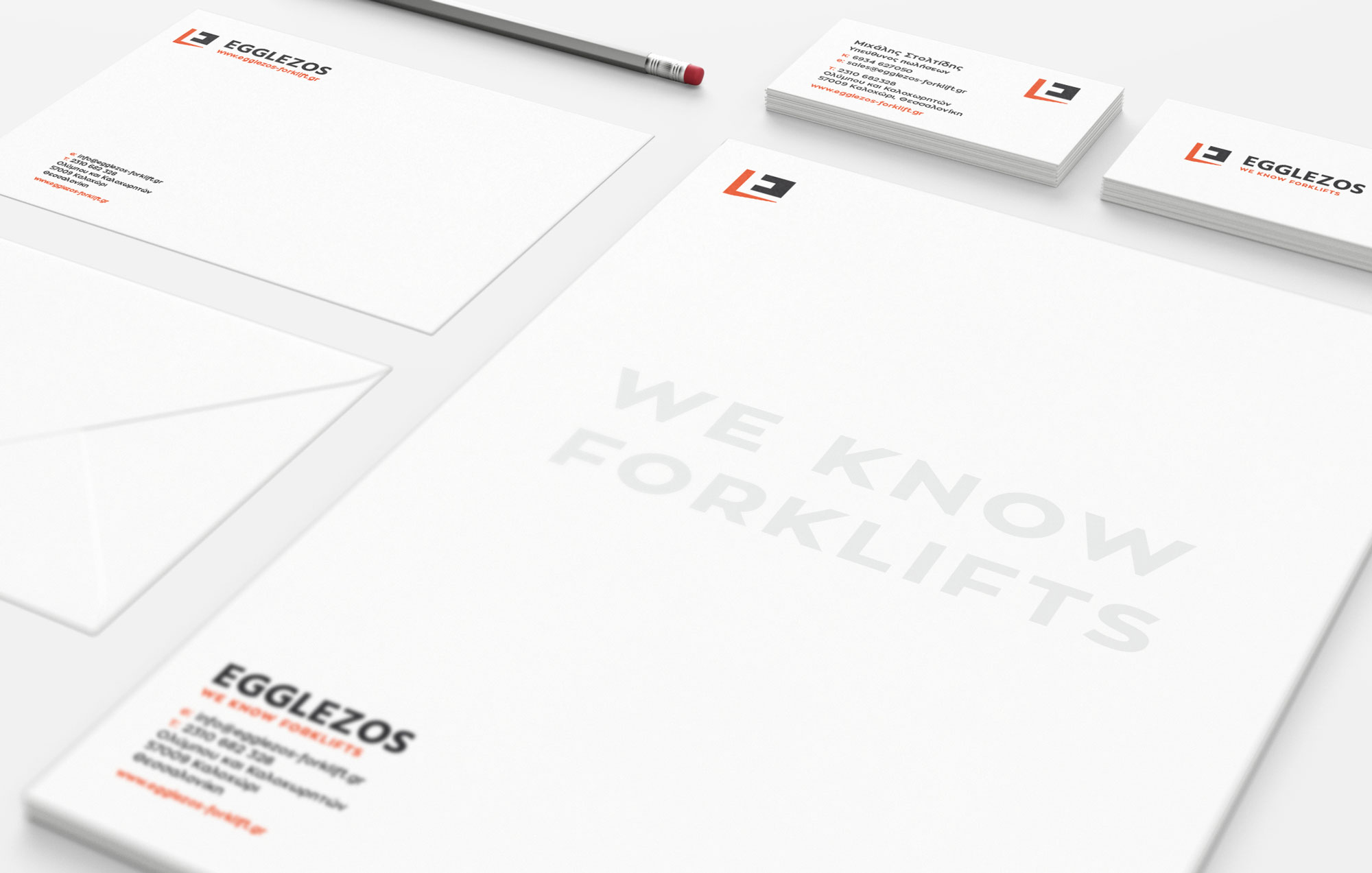 corporate identity with branding elements on letterhead and business cards